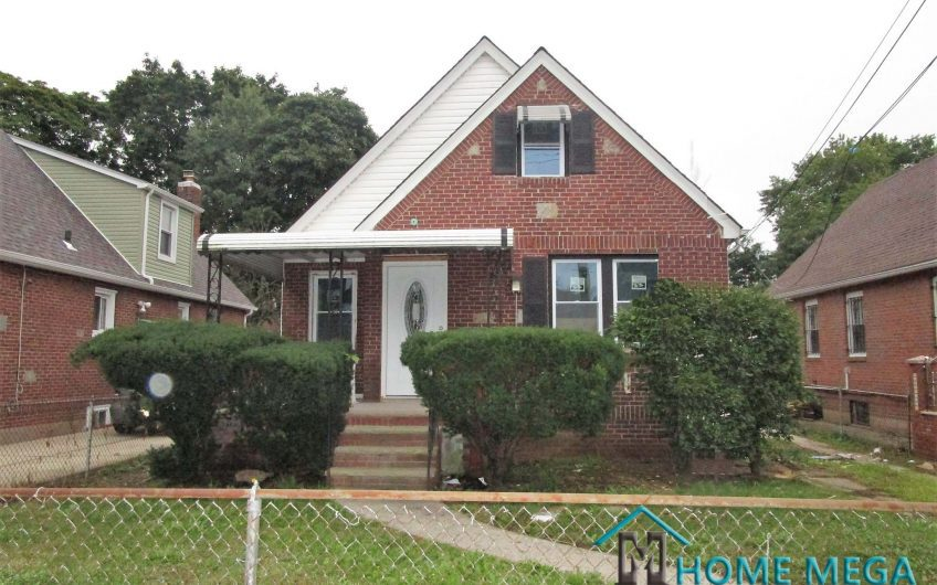 One Family Home For Sale In Jamaica, Queens NY 11435. Modernized Single Family Cape with Basement, Driveway and Garage!